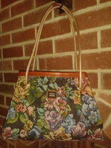 Carpet bag in blue floral tapestry with leather handle and trim